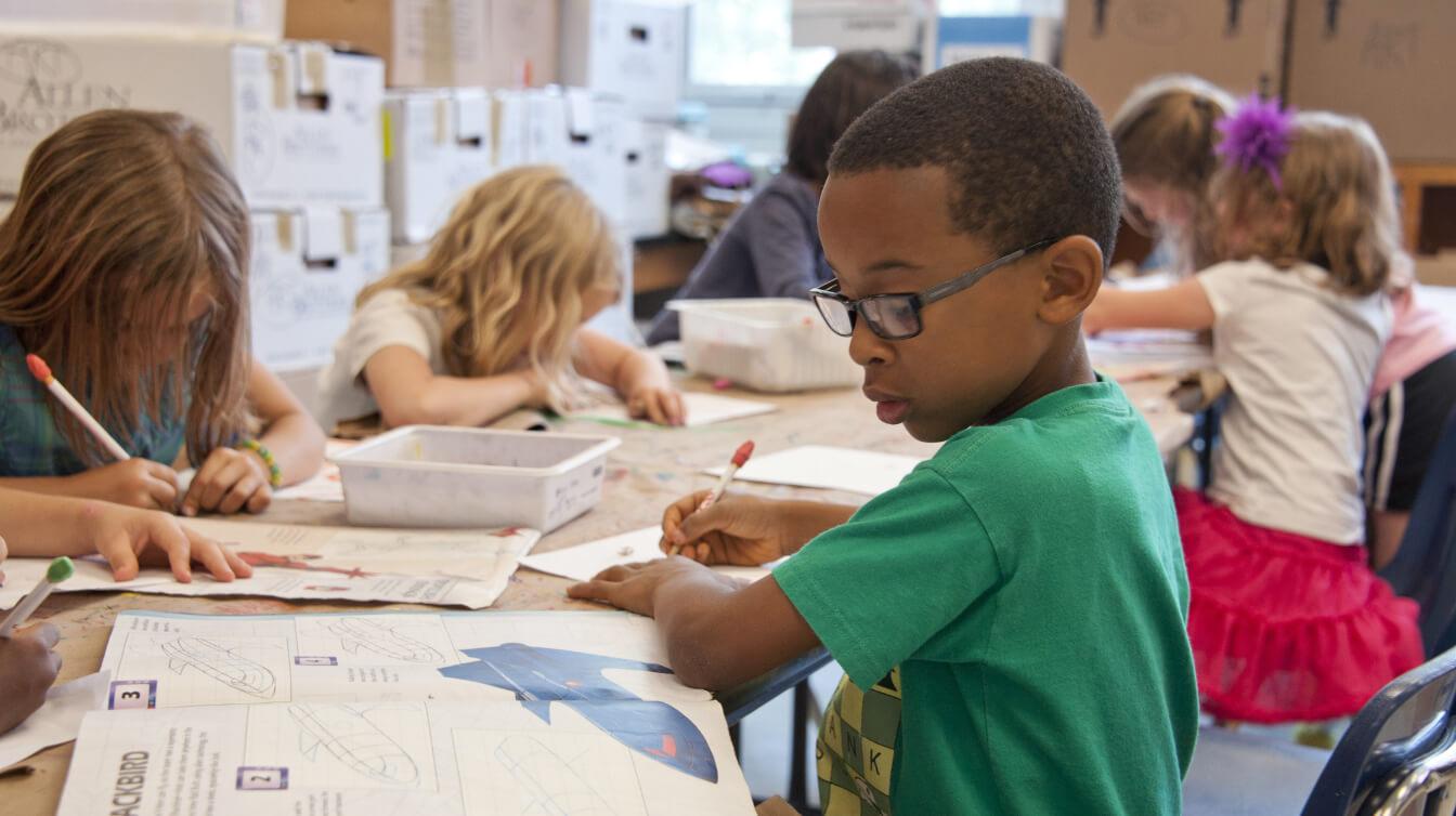 Children at school working.