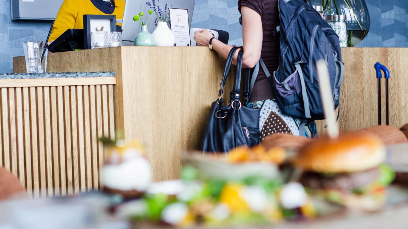 Customer at register inside restaurant.