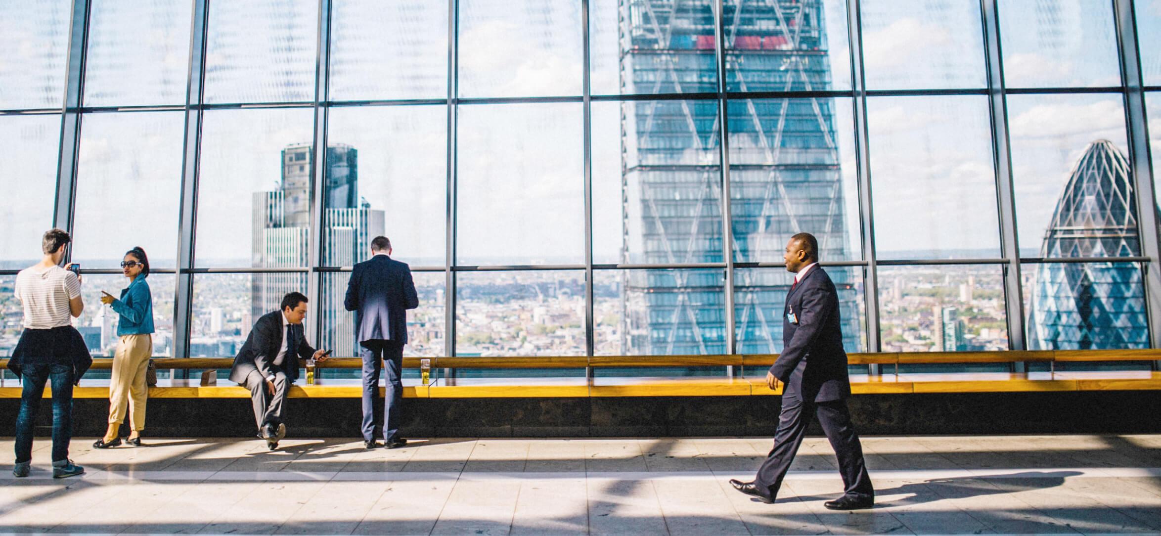 Business man walking in a beautiful building.