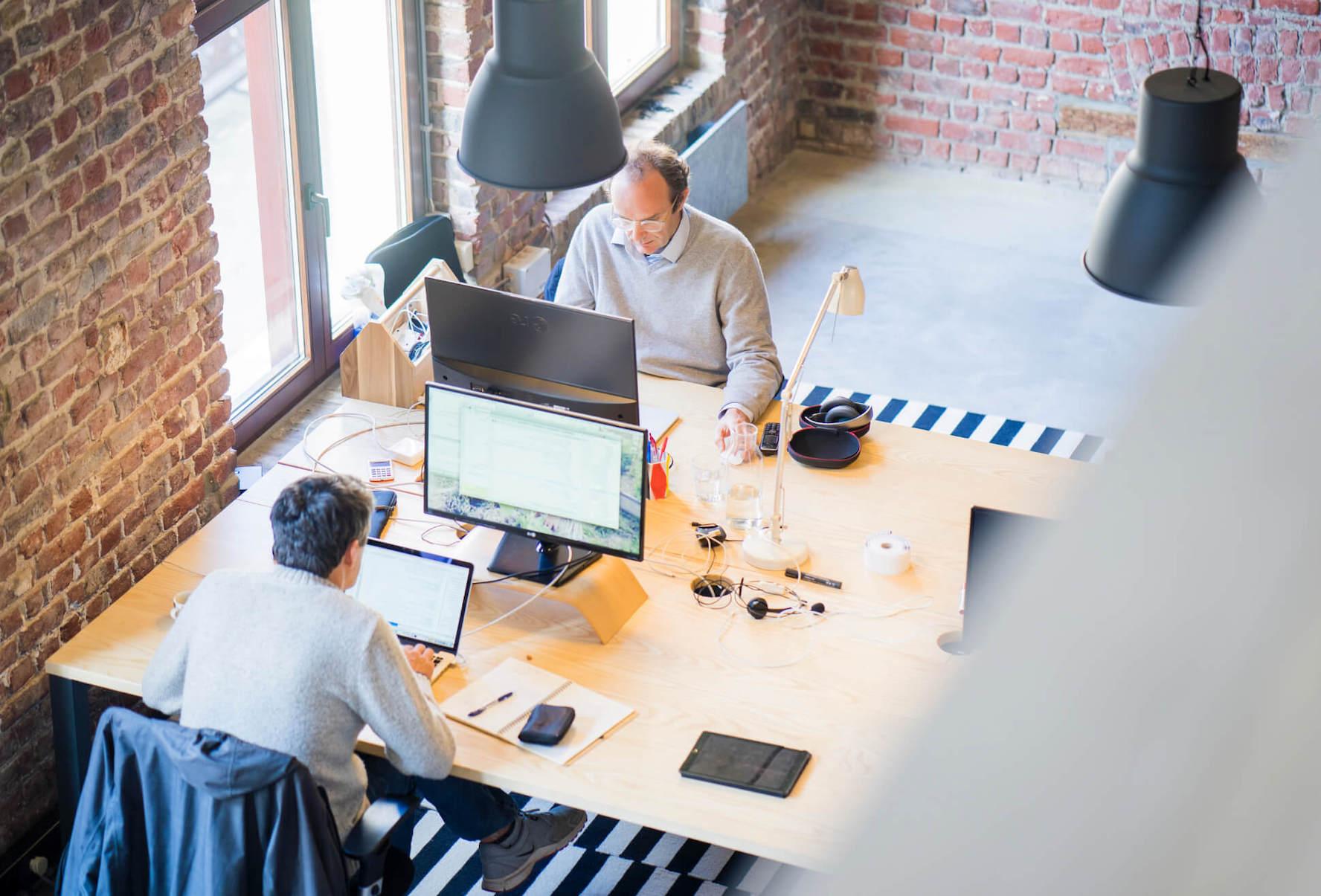 Employees working at their desks.