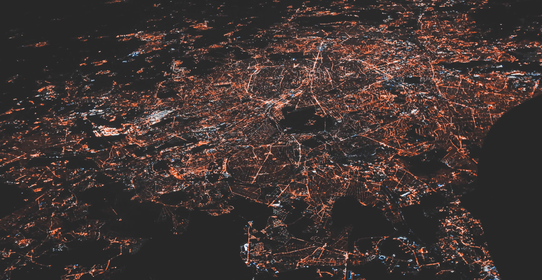 Aerial view of metropolitan area at night.