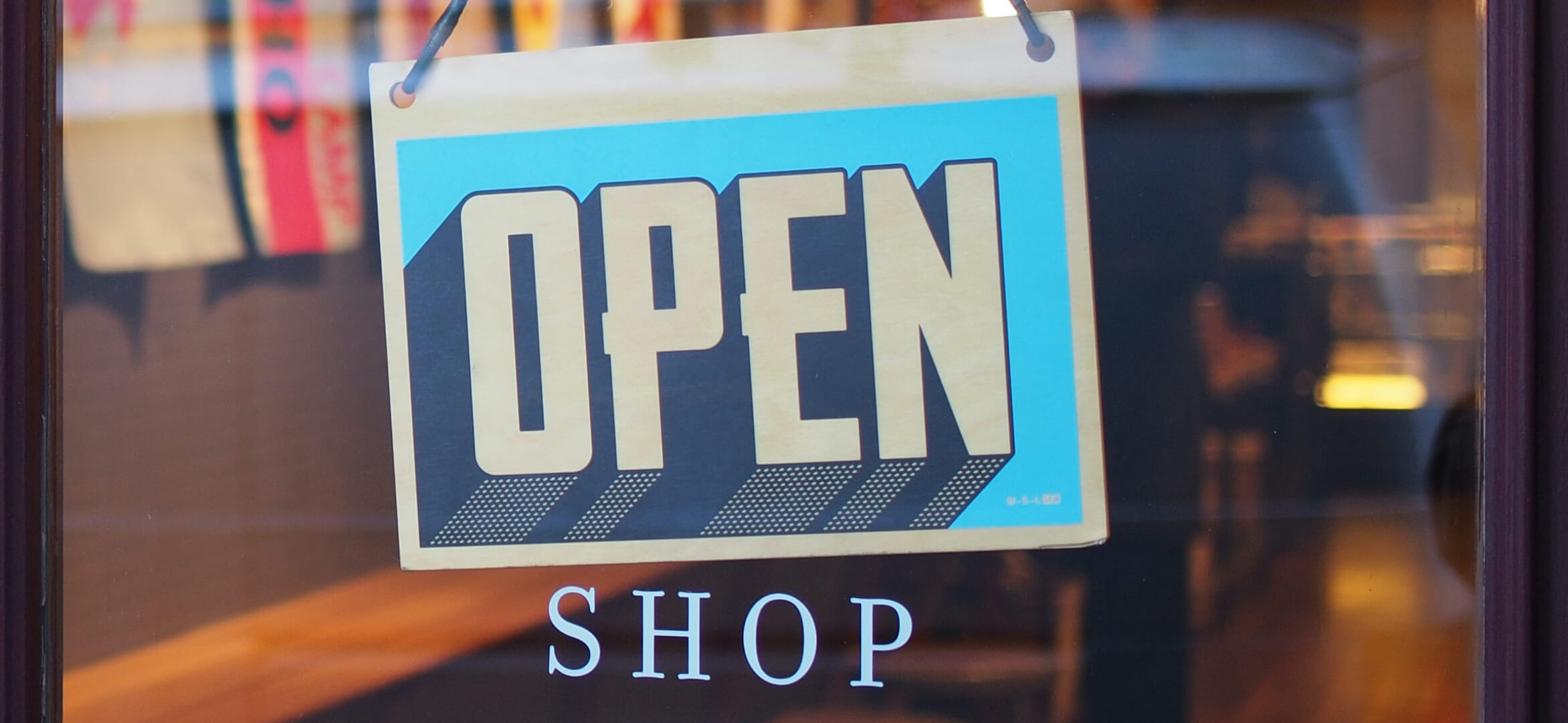 Open sign in store front.