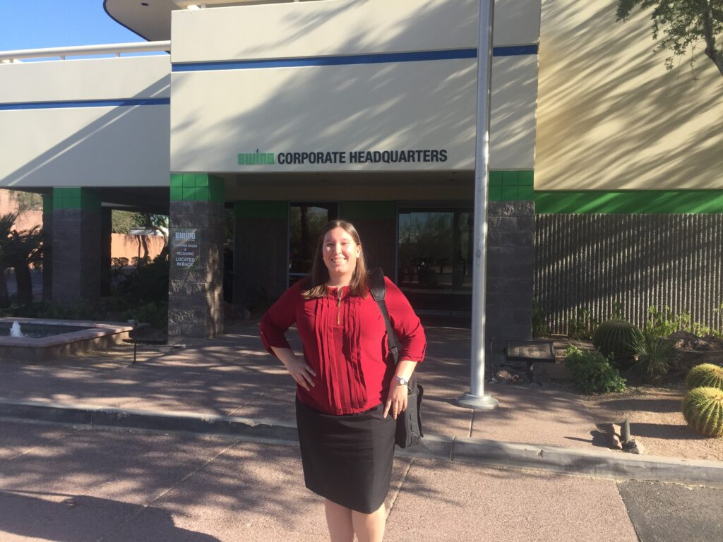 Suzanne Beltran standing in front of Ewing Irrigation Headquarters